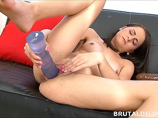 Masturbation with huge dildo is the way attractive girl prefers to spend her free time