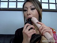 Asian girl boasts about her big collection of dildos and demonstrates it in practice 4