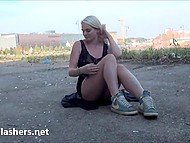 Young blonde from England lifts dress up and plugs fingers into wet pussy outdoors 4