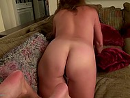 Mature lady with tanned body lies on couch and stimulates her shaved vagina with vibrator 11