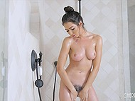 Bewitching chick entered shower to wash her slim body and stroke trimmed pussy 4