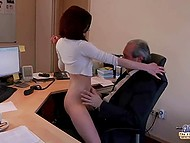 Young secretary finds unusual way to distract old boss from paperwork in office