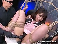 Tied Japanese teen screams and moans as two guys masturbate her pussy with vibrators