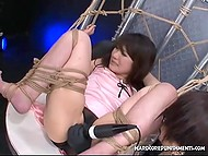 Tied Japanese teen screams and moans as two guys masturbate her pussy with vibrators 6