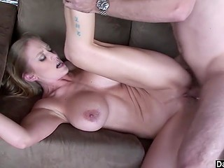 Sexed-up blonde with juicy boobs screams on couch from every penetration of strong guy