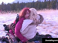 Red-haired Shanda Fau strapons her Norwegian colleague Monica MILF despite the cold and snowy weather 10