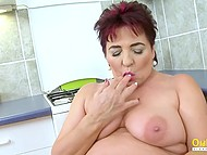 Mature BBW nanny quickly reached orgasm shoving two fingers in hairy pussy in kitchen
