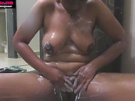 Vicious Indian MILF is used to take camera with her in bathroom to record showering her curves 4