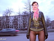 Naughty Jeny Smith lifts short skirt up to flash round booty and pussy through transparent pantyhose outdoors 11