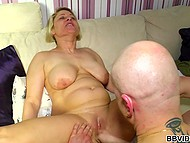 German MILF with big boobs doesn't mind having passionate sex with two big fellows 8