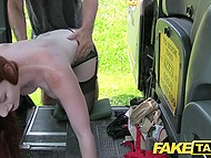 Tall redhead with strong boobs lets taxi driver stop and fuck her cunny in the car 10