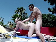 Sexy young woman with natural boobies warmed under blazing sun and fucked by poolside 11