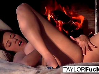 Stunning MILF Taylor Vixen lies next to fireplace and gently thrusts fingers into warm pussy
