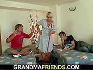 Aged cleaning woman scolds two guys for disorder in room and they need to calm her down 4