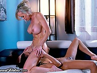 Big-boobied blonde Brandi Love and black psychologist lick and finger each other's pussy
