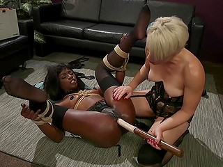 Ebony girl Ana Foxxx is tied up and dominant MILF Helena Locke does everything she wants with her