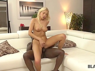 After foreplay, black cavalier slowly thrust great cock into blonde's smooth pussy