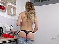 Slim sweet thing with tanned body erotically undressed and masturbated hairy pussy in kitchen 5