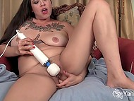 Tattooed female can't stand a day without masturbating her shaved pussy with adult toy 8