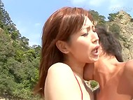 Exotic Japanese teen with hairy bush demonstrates naked body and gets fucked hard on wild beach 4