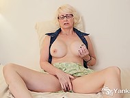 Mature blonde with great breasts spread legs wide and fingered hairy vagina
