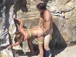 Married couple does it by the rock on beach but doesn't know they getting recorded by curious tourist