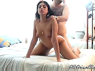 Middle-aged man with hairy chest relaxes and lets younger Arab girl ride his erect boner