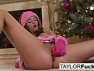 Ravishing sweetie Taylor Vixen in Christmas cap stimulates pussy by Christmas tree 5