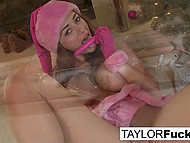 Ravishing sweetie Taylor Vixen in Christmas cap stimulates pussy by Christmas tree 6