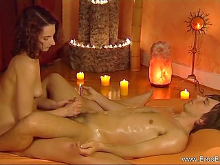 Tutorial video where relaxed guy with oiled body enjoys handjob by fetching girl