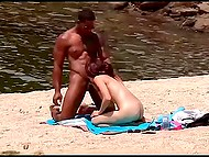 Ebony buddy finds nudist beach where petite chick isn't against some fun with him 5