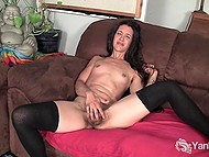 Brunette tried on beautiful stockings and actively stimulated hairy vagina alone