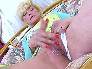White-headed mature female strokes buttocks and masturbates vagina alone