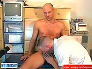 Excited twink helps partner take off clothes and sucks cock until man erupts cum on his face