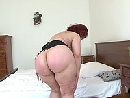 Old chubby woman with red hair sets favorite dildo into play in solo porn video 4