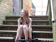 Teenage British flasher opens her summer dress to tickle shaved pussy on stairs outdoors 4