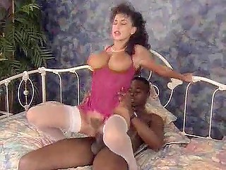 Vintage sextape with busty pornstar Sarah Young riding big chocolate stick with hairy pussy