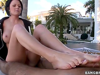 Stunning big-tittied brunette relaxes partner's pretty penis with gentle outdoor footjob