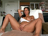 Black-haired Latina cougar with awesome curves passionately fingers bald cunny alone 3