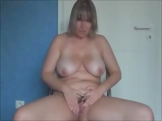 Mature hot and horny woman pleasing herself