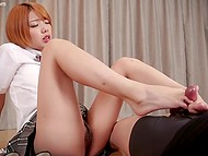Red-haired college girl from Japan takes off panties and teases hard cock with slim feet