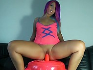 Petite German alt girl with colorful hair and round booty takes a ride on inflatable dildo
