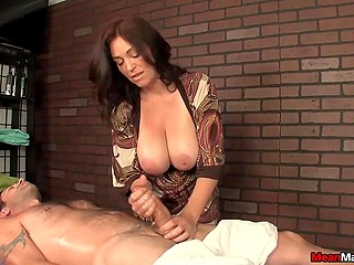 Suntanned brunette with great breasts gave visitor relaxing massage and awesome handjob