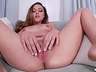Attractive chick slowly took off black panties and went to finger pussy on couch 4
