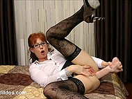 Mature lady with red hair and in sexy stockings easily pushes huge dildo into asshole 6