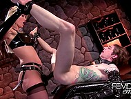 Blonde-haired dominatrix strapons tattooed prisoner's anal hole in gloomy dungeon