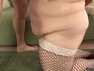 Chubby girl in fishnet stockings strokes man's cock with hands after fucking to make him cum over tits 10