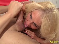 Blonde mature in stockings rides big penis of black man who cums over her tits 10