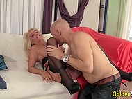 Blonde mature in stockings rides big penis of black man who cums over her tits 5