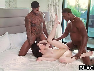 Brunette sucks huge cock of tattooed black man and his friend joins them a little bit later